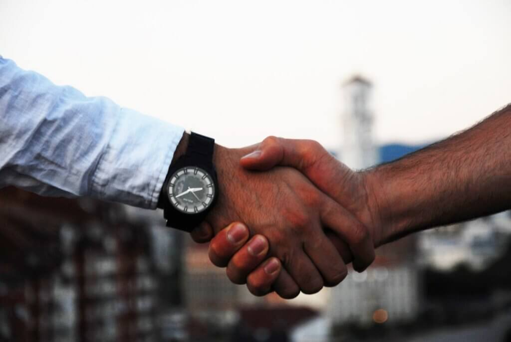 sales person shaking hands with client